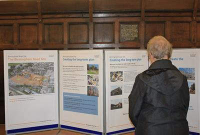 image of woman looking at Birmingham Road Site information board
