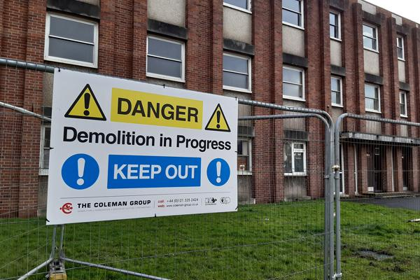 image of danger demolition in progress sign in front of old police station
