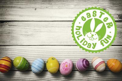 painted Easter eggs in a row with Easter holiday fun logo above