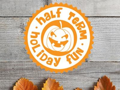 Halloween half term logo on a background with autumn leaves along the bottom