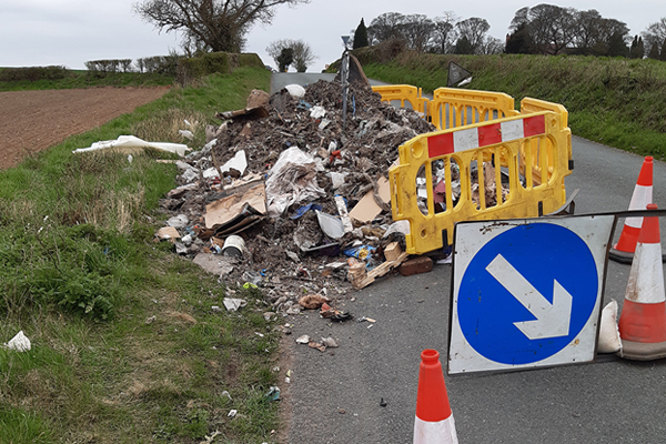 fly-tipping blocking one side of a road