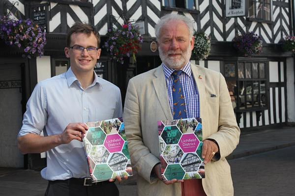 Jonathan Percival and Councillor Ian Pritchard holding investment prospectus
