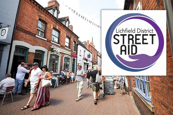 city centre street with street aid logo