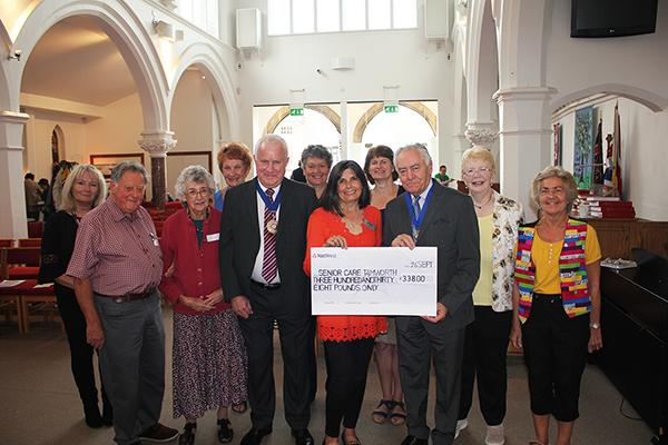 group of people with former chairman and Karen holding giant cheque