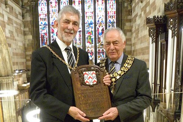 David Leytham and Bob Awty holding plaque in St Mary's