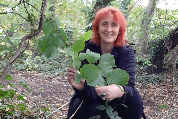 Ruth in woodland holding leaves