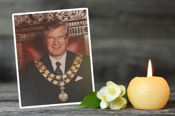 Portrait of Tony Nichols next to flower and candle