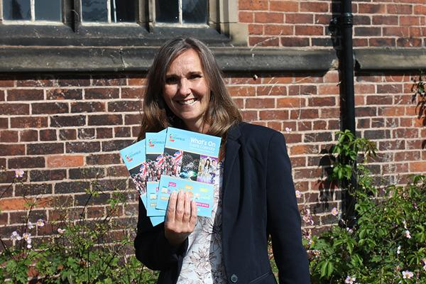 Woman holding what's on brochures