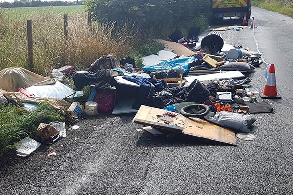 image of waste dumped on the side of a road