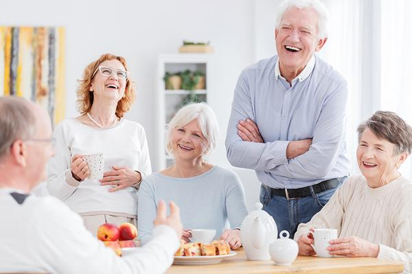 group of older adults smiling and chatting