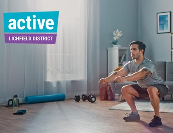 image of man exercising at home