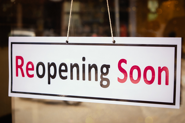 reopening soon shop window sign