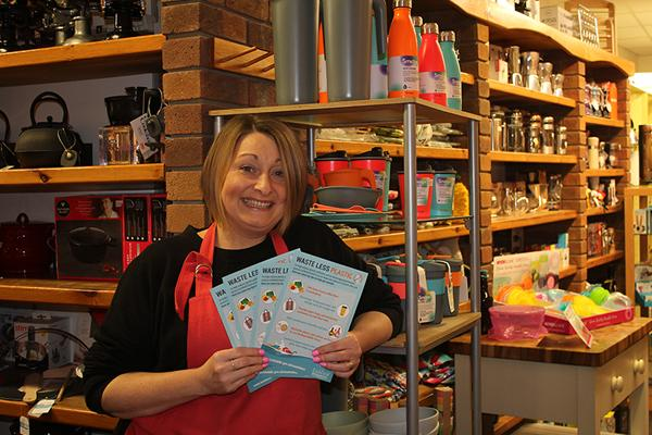 sales person holding flyers in the kitchen shop in lichfield