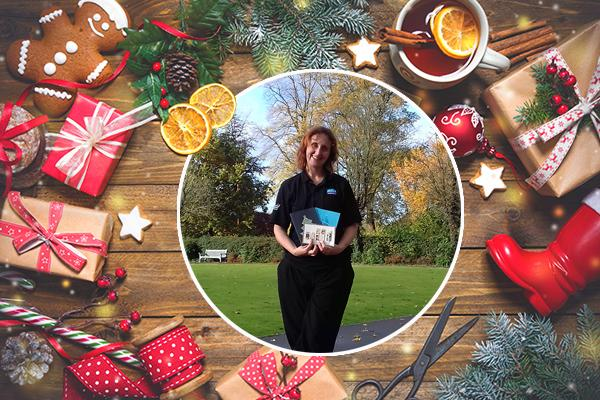 festive scene with picture of woman holding handmade Christmas cards